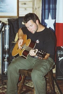 Brandon playing guitar